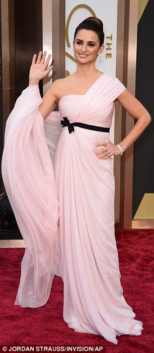 Light and dark: Penelope Cruz switched from a light pink frock to a dark one