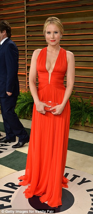 Switch-up: Kristen Bell arrived at the Oscars in an off-white gown but changed into a plunging red number for the Vanity Fair afterparty