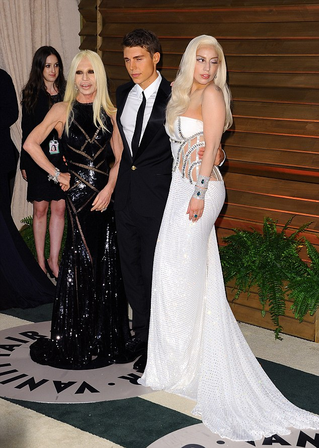 Quick change: Later on, Gaga slipped into a cut-out bridal gown as she posed with Donatella Versace at the Vanity Fair Oscar Party hosted by editor Graydon Carter at the Sunset Plaza