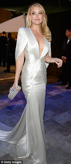 So much choice: Kate Hudson dazzled in a silvery plunging dress before changing into a sheer black and nude number