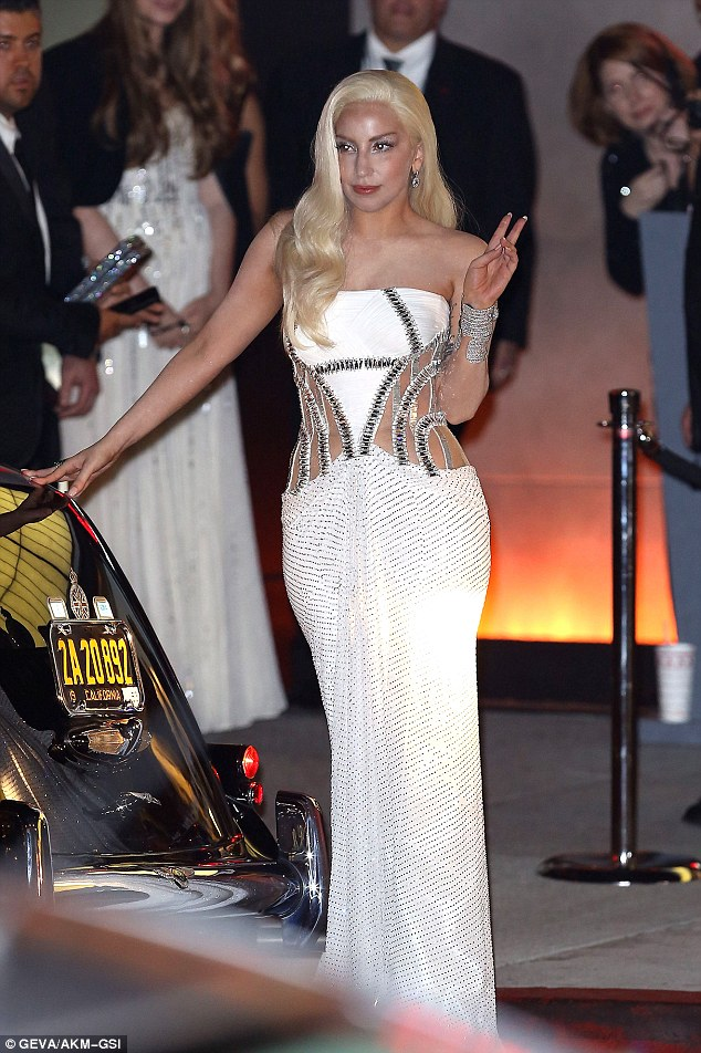 Farewell: The singer waves and blows kisses to her fans upon leaving the Vanity Fair Oscar After Party