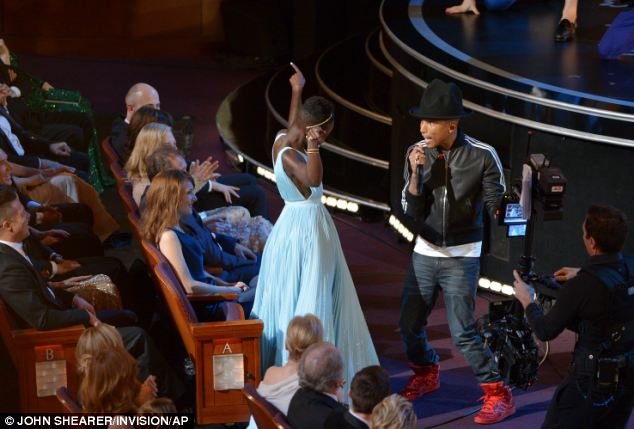 Bust a move: Oscar-nominated actress Lupita Nyong'o danced along with Pharrell Williams as he performed his hit song