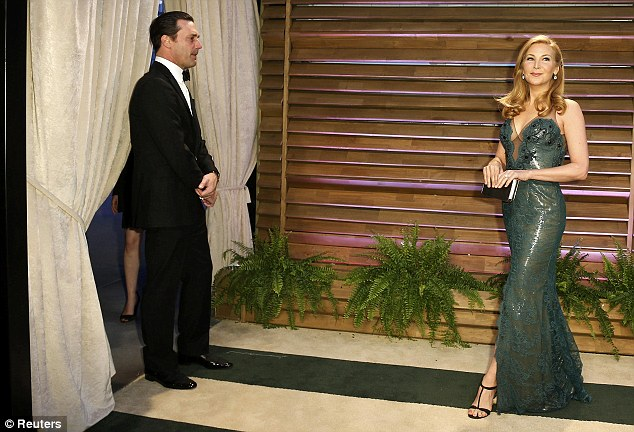 The look of love: Jon admires his partner of 16 years as she walks into the party