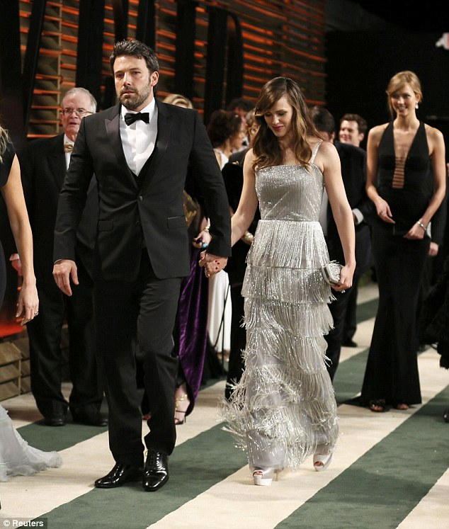 Loving couple: Ben Affleck and Jennifer Garner head into the party, hand-in-hand