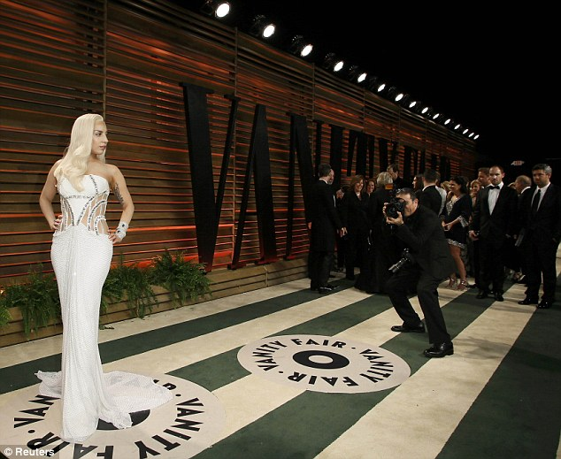 Pose: Lady Gaga arrives at the 2014 Vanity Fair Oscars Party in West Hollywood