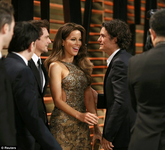 Brits Abroad: Kate Beckinsale and her husband are greeted by actor Orlando Bloom