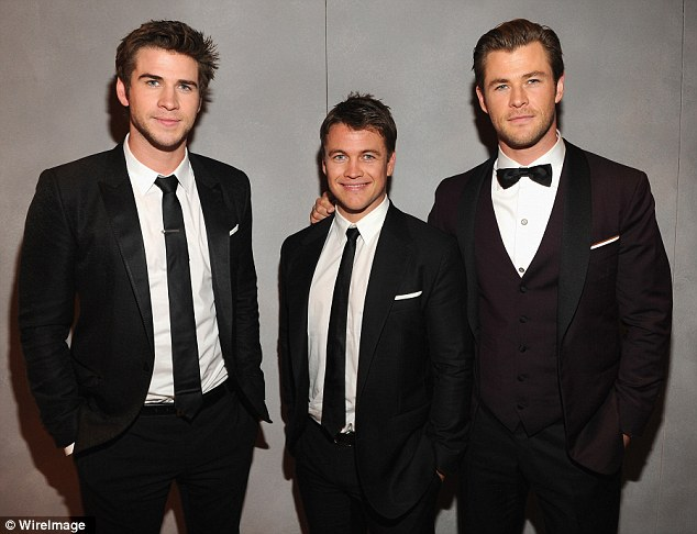 The brothers Hemsworth: Liam, Luke and Chris hang out together at the bash