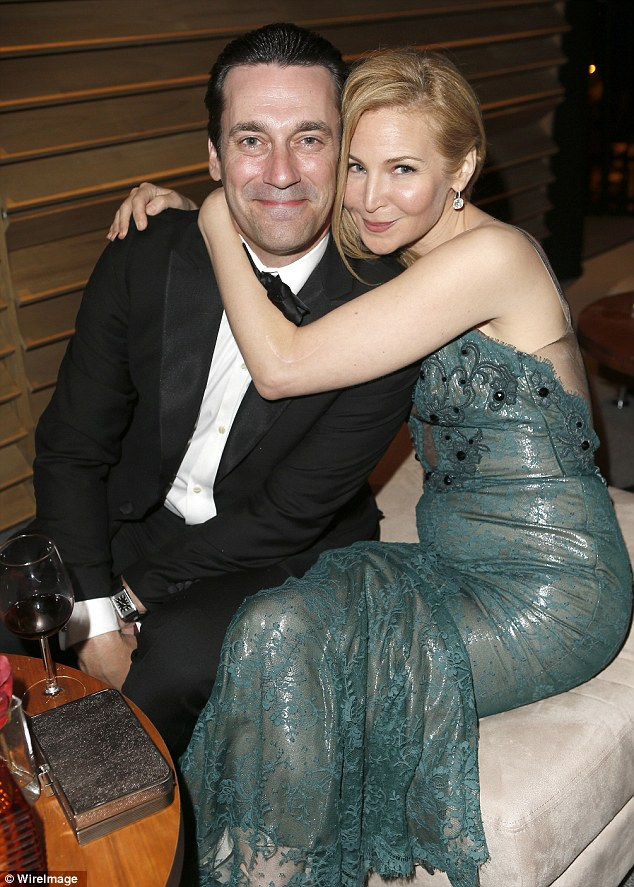 Her mad man: Jessica Westfeldt keeps close to her partner Jon Hamm