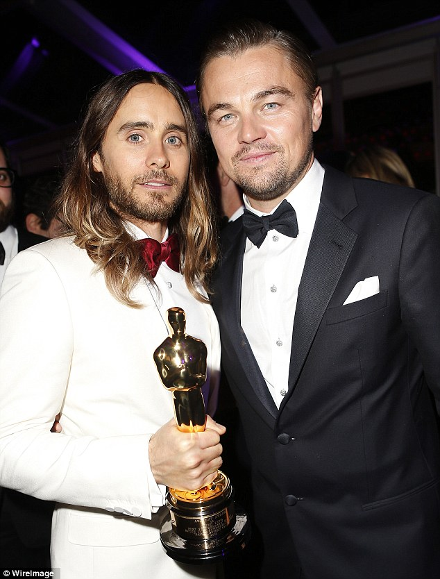 Rub it in then Jared Leto: The Oscar winner won't put down that trophy, even with four-time loser Leonardo DiCaprio