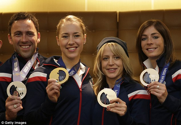 Winter Olympic Team GB's winners David Murdoch, Lizzy Yarnold, Jenny Jones and Eve Muirhead pose with their medals