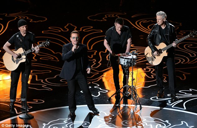 Nominees: The Edge, Bono, Larry Mullen Jr., and Adam Clayton of U2 gave an emotional performance of their song Ordinary Love