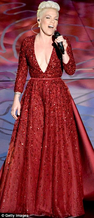 Taking the plunge: Pink performed in a plunging red dress inspired by Dorothy's slippers in Wizard Of Oz while Idina Menzel wowed in a flowing pale number