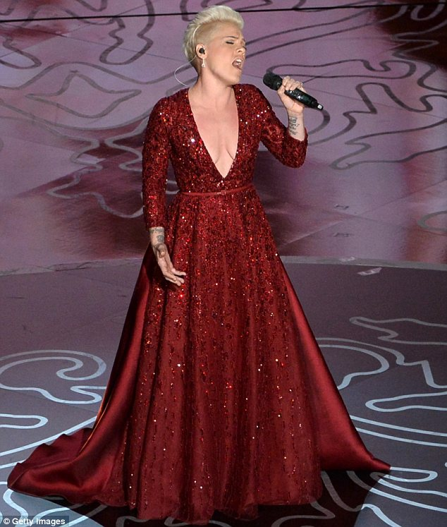 Paying tribute: Pink's exquisite gown was designed to pay tribute to the ruby red slippers worn by Garland's character Dorothy in the Wizard Of Oz