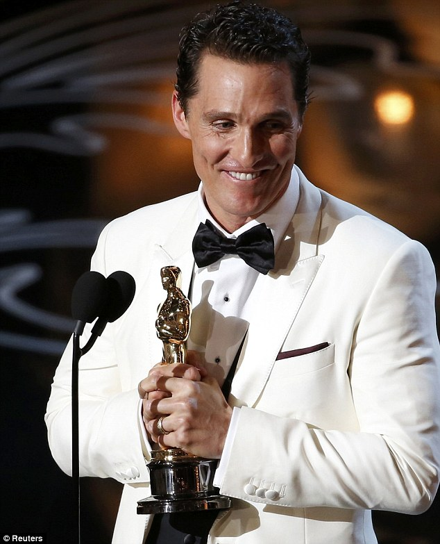 Overjoyed: The delighted star was beaming as he held his well-deserved prize in front of his peers