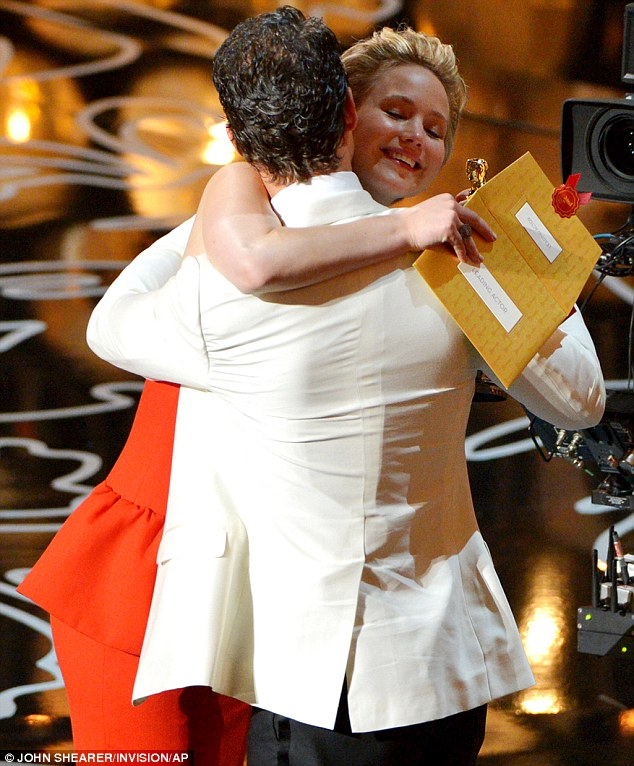 Hugging it out: And when he finally made it onstage he gave award presenter Jennifer Lawrence a warm embrace