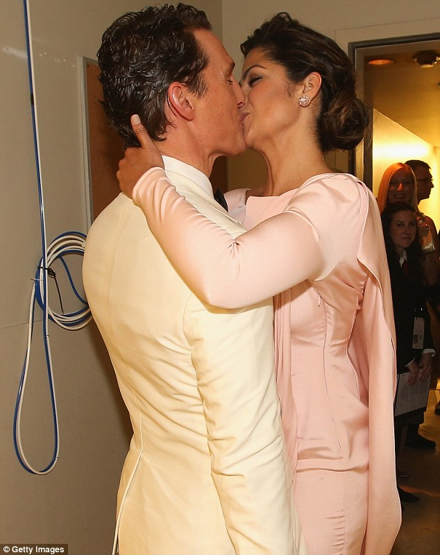 Trophy wife: And Camilla gave her Oscar-winning man a lingering kiss to make his dream night even better