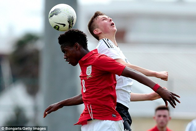 Aerial duel: Joshua Onomah challenges Ole Kauper in the air during the match at the Municipal Stadium in Lagos, Portugal