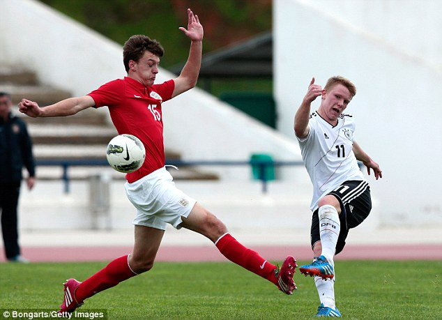 Block: Dael Fry tries to intercept a shot from Germany's Philipp Ochs