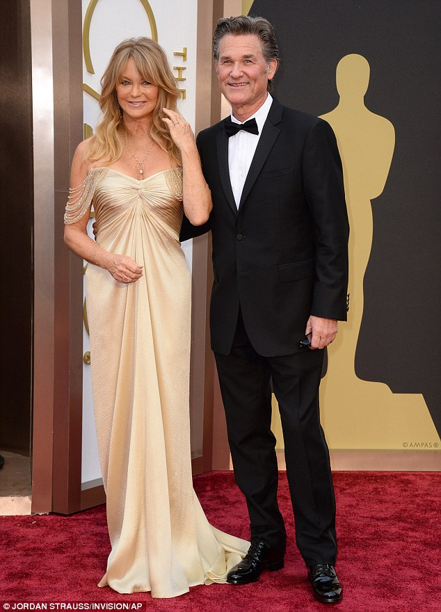 Beauiful family: Goldie and partner Kurt have one of Hollywood's longest surviving relationships