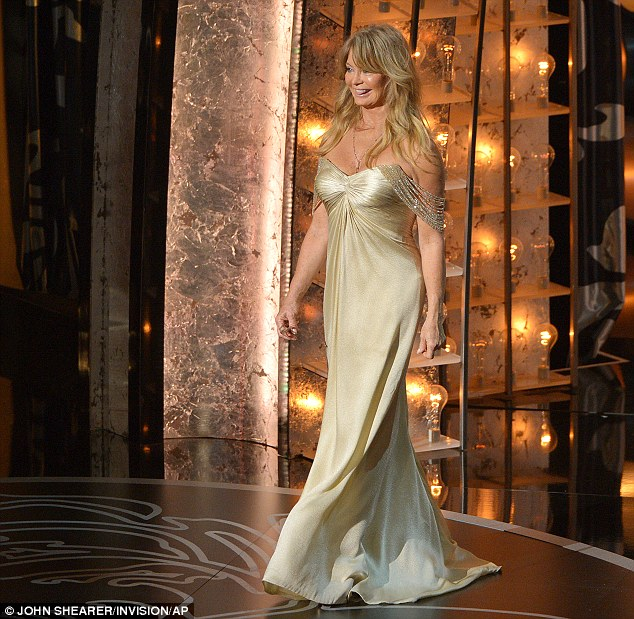 Lit up in a warm glow of gold: Goldie was her usual jovial self as she presented at the annual awards ceremony