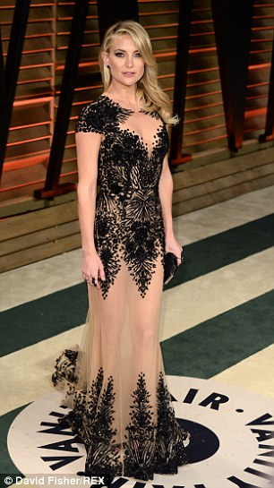 Nude elegance: Kate later slipped into a nude and black dress for the Vanity Fair Oscars party looking even more like her mother