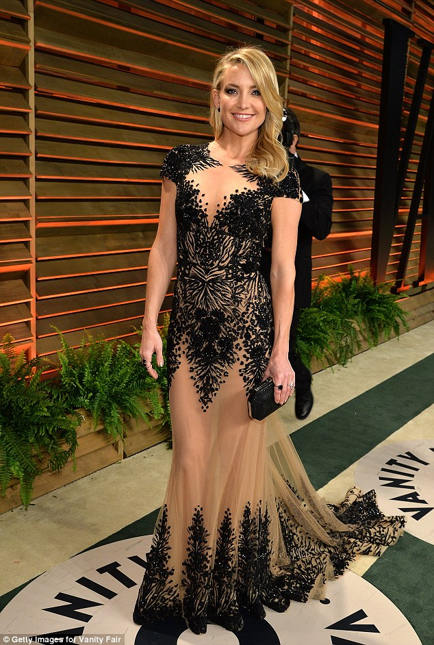 Switching to nude: Kate later swapped her dress but kept her hair golden and to one side to attend the Vanity Fair Oscar Party hosted by Graydon Carter