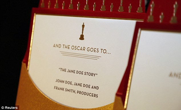 Top secret: They are then stuffed with thick white cards baring the tagline: 'And the Oscar goes to...' and sealed with a shiny red sticker and matching ribbon