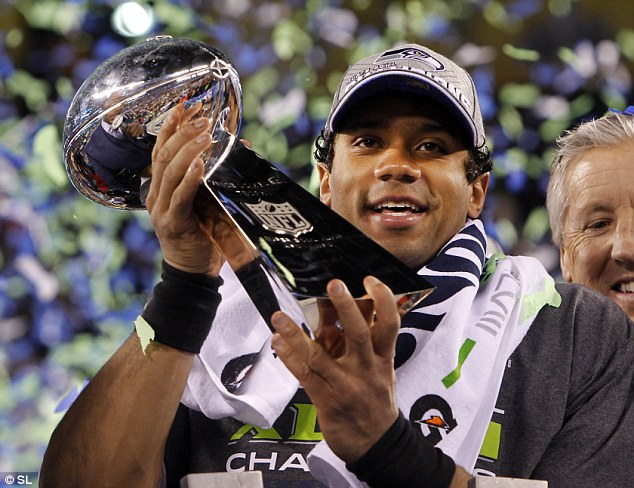 Victorious: Russell Wilson with the Lombardi trophy after the Seahawks' victory against the Denver Broncos in February
