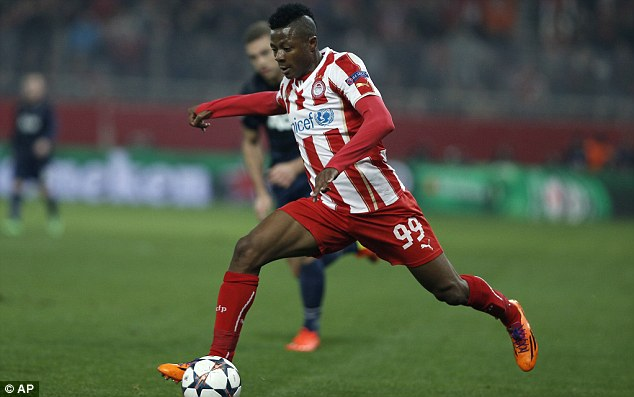 Talent: Olaitan runs with the ball during Olympiacos' 2-0 Champions League win against Manchester United