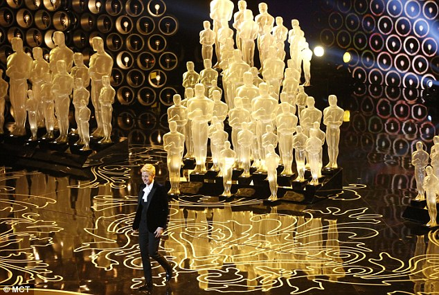 Ellen DeGeneres arrives in Elton John's living room for his annual Oscars' party. Or rather, on stage at the Dolby Theatre in Los Angeles - the slightly less showy of the two