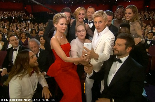 Jared Leto (left, seated) shows how he nearly left it too late for his eye to make it in to the selfie (picture above) that went on to have the Most Re-Tweets in the history of Twitter. So far...