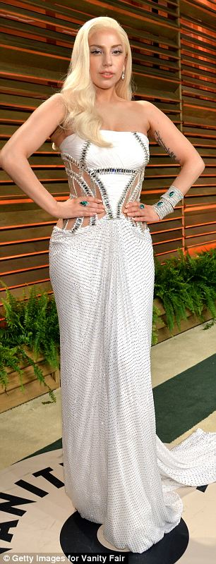 Gaga swapped one extremely uncomfortable-looking dress for another extremely uncomfortable-looking dress by the label as the night wore on