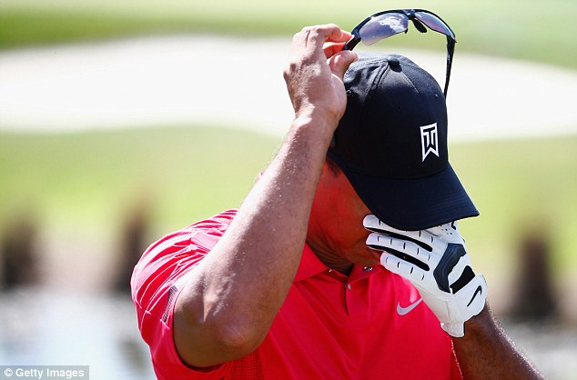 Worrying times: Tiger Woods quit midway through his final round citing a back injury