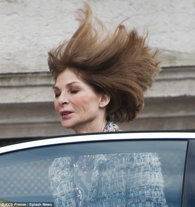 Hair-raising: Anna Wintour is rarely seen with a hair out of place but as she attended Paris Fashion Week this morning her static bob got the windswept treatment