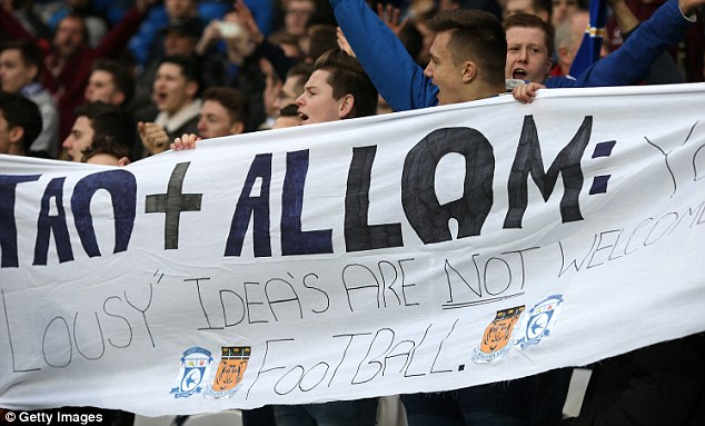 Unhappy: Disgruntled Cardiff supporters protest against Tan