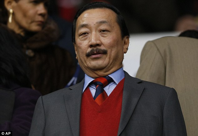 Under scrutiny: Cardiff City owner Vincent Tan made an illegal offer to players