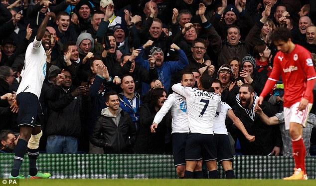 Gutted: Fabio Da Silva looks to the ground as Spurs celebrate Soldado's winner