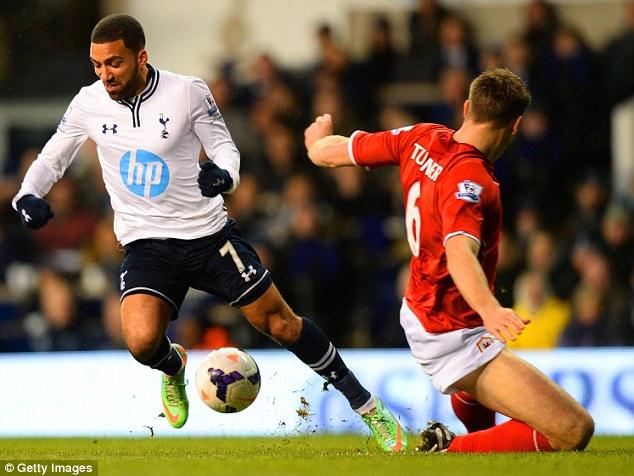 Left for dead: Aaron Lennon ghosts past Cardiff defender Ben Turner