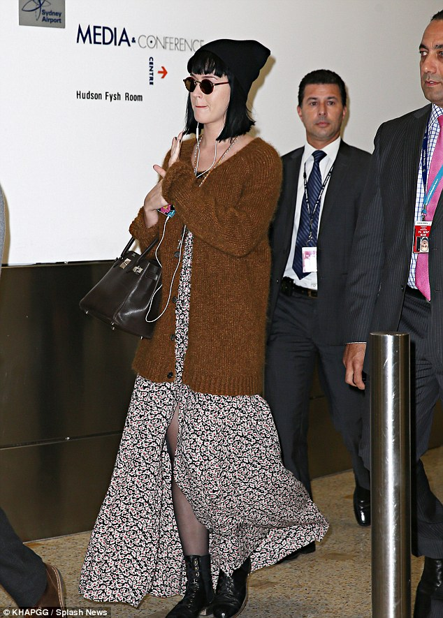 Additional measures: She was accessorised by Lennon-like round sunglasses and a dark beanie that blended in with her jet black locks.