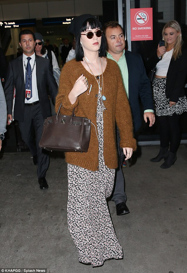 Famous: Fans took pictures of Perry as she strolled through the airport