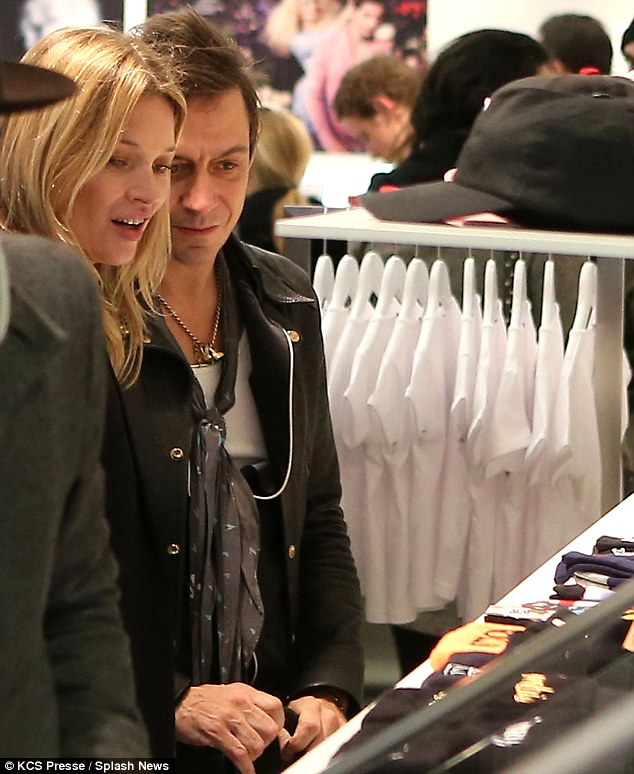 A gift in mind? The couple seemed to be browsing over children's clothing at one point as they enjoyed their afternoon of high-end shopping