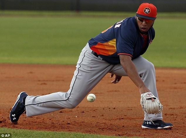 Houston Astros' Jon Singleton fields a ground ball during a spring training baseball workout, Friday, Feb. 21, 2014, in Kissimmee, Fla.