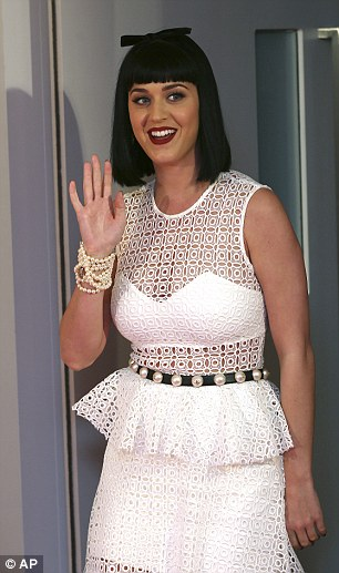 All white, it's Katy! The Roar singer looked happy as she waved at fans at the brief appearance in Sydney