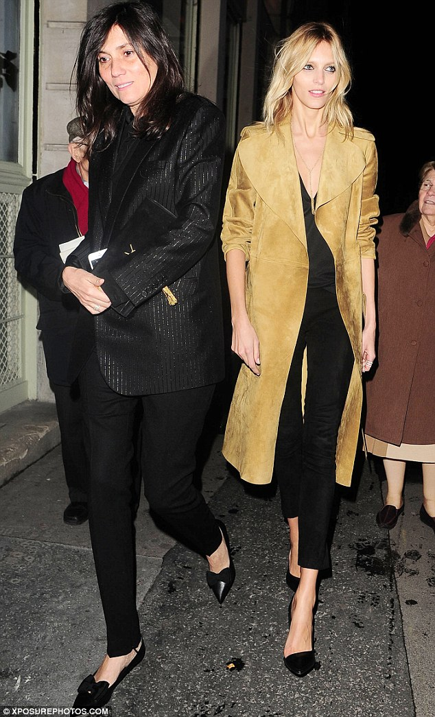 Contrasting looks: Vogue Paris editor Emmanuelle Alt and Anja Rubik were also seen arriving the show