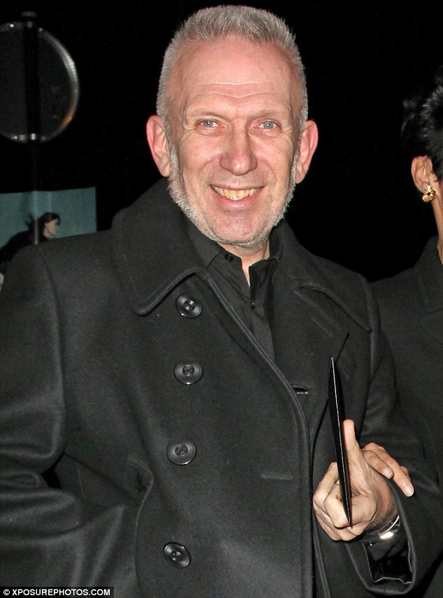 Pleased as punch: Jean Paul Gaultier looked happy as he left the venue in a black wool coat and matching shirt