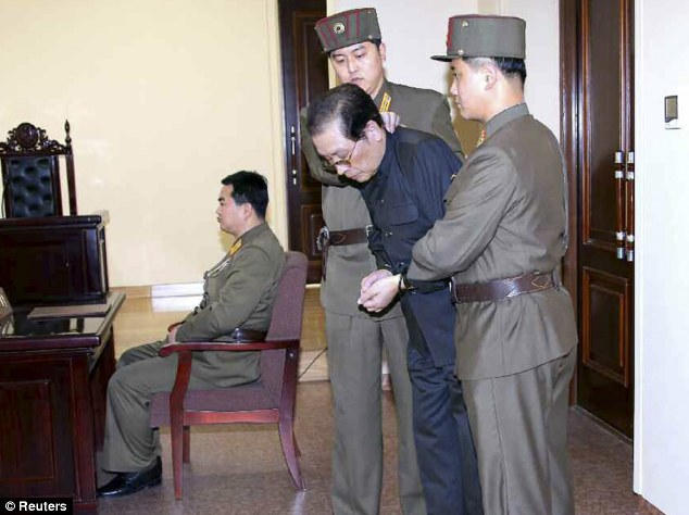Executed: Jang Song Thaek, previously considered the second most powerful man in the secretive state, is seen with his hands bound as he is dragged into the court by uniformed personnel  shortly before his death