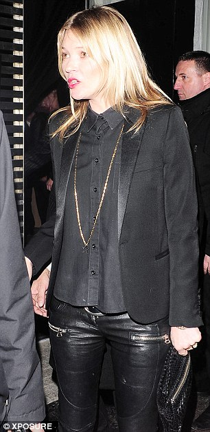 All tuxed up: Kate wore a black shirt buttoned up with a gold necklace and tuxedo jacket