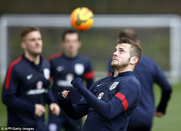 Eyes on the prize: Jack Wilshere shows off his skills during England's training session on Monday