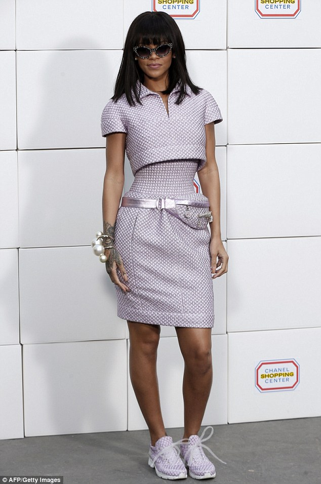 Bang, bang: Rihanna was seen looking pretty in purple at the Chanel 2014/2015 Autumn/Winter ready-to-wear collection fashion show during Paris Fashion Week on Tuesday