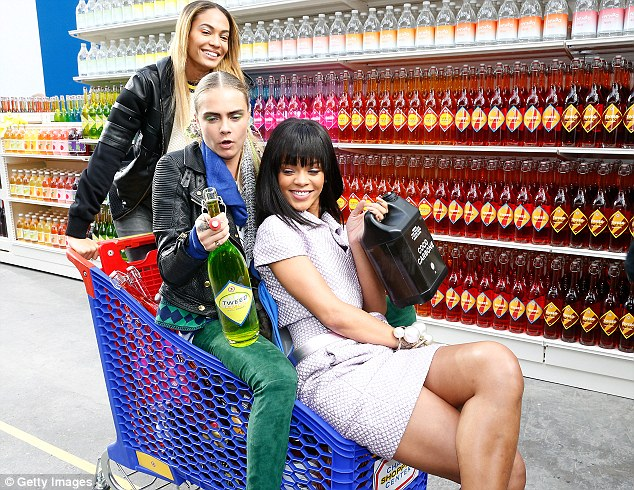 Supermodel sweep: Showbiz besties Cara Delevingne, Joan Smalls and Rihanna extended their fun nature to the Chanel catwalk after the iconic French label's Paris Fashion Week AW14/15 show on Tuesday